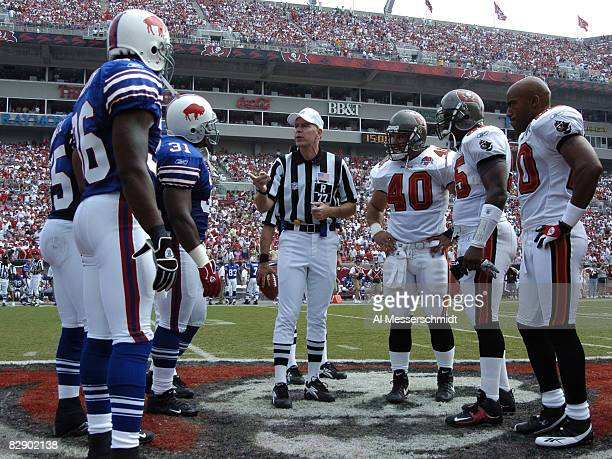 NFL referee Terry McAulay lines up for the coin toss as the Tampa Bay Buccaneers host the Buffalo Bills September 18 2005 in Tampa