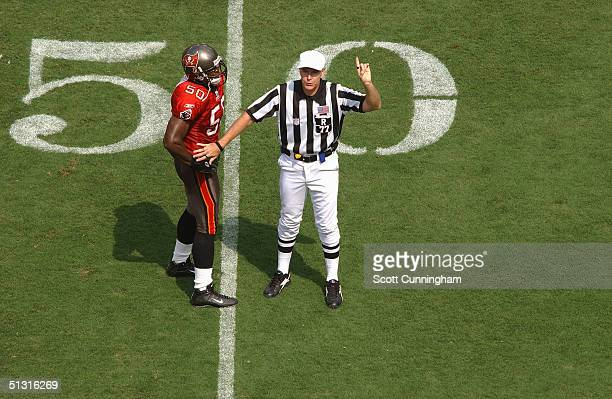 Referee Terry McAulay makes a call while Jeff Gooch of the Tampa Bay Buccaneers listens during the game against the Washington Redskins on September...