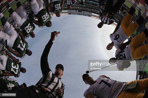 Referee Terry McAulay presides over the coin toss with the captains of the Pittsburgh Steelers and the New York Jets at MetLife Stadium on November 9...