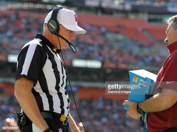 Referee Terry McAulay puts on his headset as he reviews a play in the second quarter of a game on October 22 2017 between the Tennessee Titans and...
