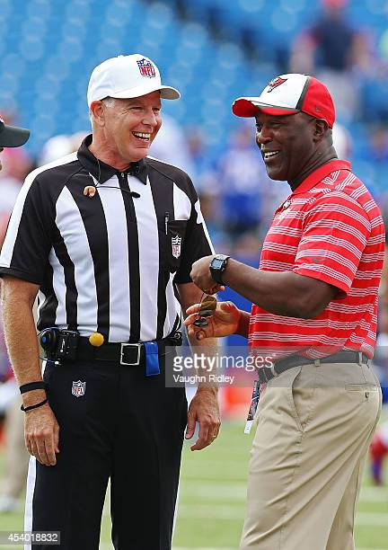 Referee Terry McAulay talks to head coach Lovie Smith of the Tampa Bay Buccaneers before the game against the Buffalo Bills at Ralph Wilson Stadium...