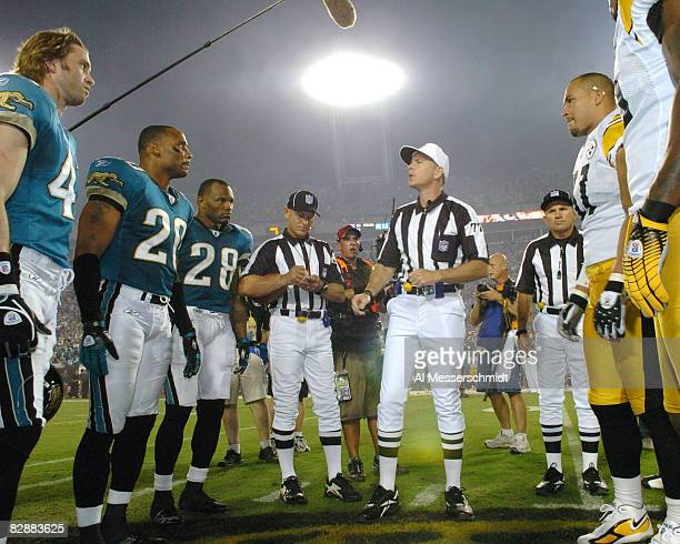 NFL referee Terry McAulay tosses the coin during the game between the Pittsburgh Steelers and the Jacksonville Jaguars at Alltel Stadium in...
