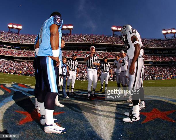 Referee Terry McAuley conducts coin toss before game between the Tennessee Titans and Oakland Raiders at The Coliseum in Nashville Tenn on Sunday...