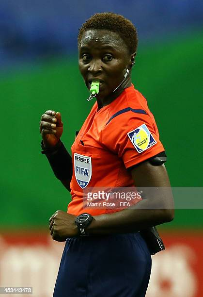 Referee Therese Sagno of Guinea gestures during the FIFA U20 Women's World Cup 2014 group D match between New Zealand and France at Olympic Stadium...