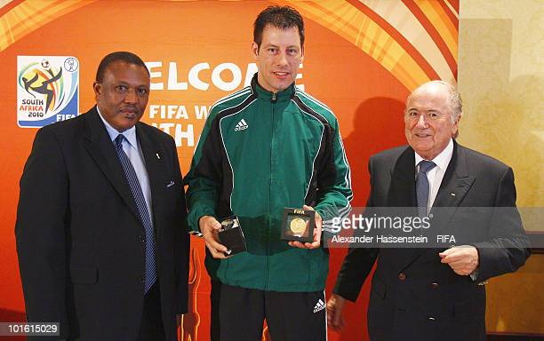 Referee Thorsten Kinhoefer of Germany pose with FIFA president Joseph S Blatter and organising chairman Irvin Khoza during the welcome and opening...