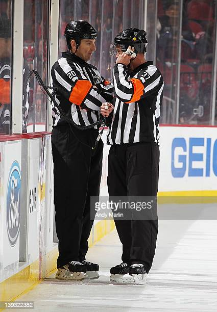 Referee Tim Peel and referee Kyle Rehman wait for a decision on the disputed goal by Ryan Getzlaf of the Anaheim Ducks in the overtime during the...