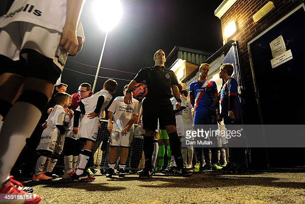 Referee Tim Robinson prepares to lead out the teams during the FA Cup First Round match between WestonSuperMare and Doncaster Rovers on November 18...