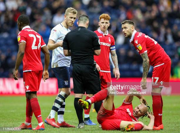 Referee Tim Robinson talks to Preston North End's Jayden Stockley after a challenge on Nottingham Forest's Yohan Benalouane during the Sky Bet...