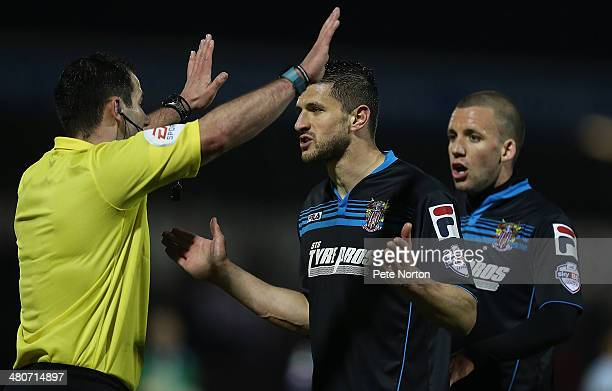 Referee Tim Robinson waves away the protest of John Mousinho of Stevenage after awarding a penalty to Coventry City during the Sky Bet League One...
