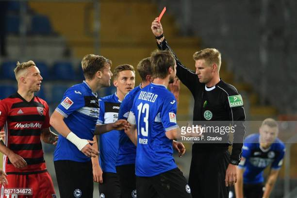 Referee Timo Gerach shows the red card to Brian Behrendt of Bielefeld during the Second Bundesliga match between DSC Arminia Bielefeld and FC...