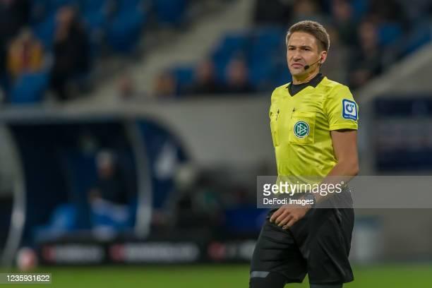 Referee Tobias Reichel Looks on during the Bundesliga match between TSG Hoffenheim and 1. FC Köln at PreZero-Arena on October 15, 2021 in Sinsheim,...