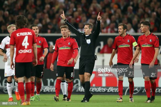 Referee Tobias Stieler gestures during the Bundesliga match between VfB Stuttgart and SportClub Freiburg at MercedesBenz Arena on October 29 2017 in...