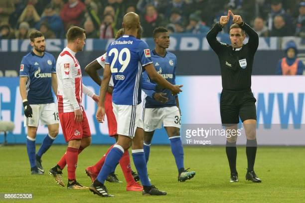 Referee Tobias Stieler gestures during the Bundesliga match between FC Schalke 04 and 1 FC Koeln Bundesliga at VeltinsArena on December 2 2017 in...
