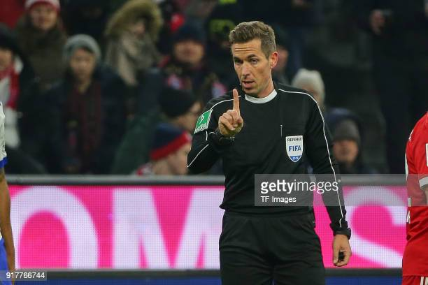 Referee Tobias Stieler gestures during the Bundesliga match between FC Bayern Muenchen and FC Schalke 04 at Allianz Arena on February 10 2018 in...