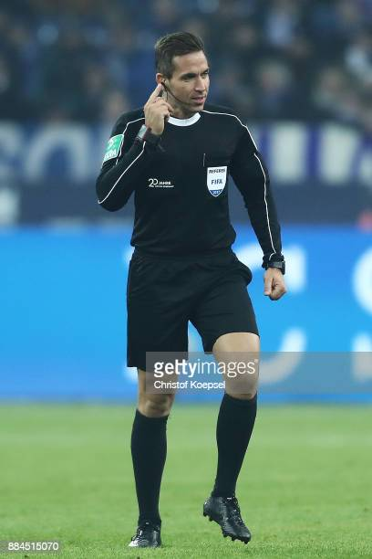 Referee Tobias Stieler listens to the video referee on his headset during the Bundesliga match between FC Schalke 04 and 1 FC Koeln at VeltinsArena...