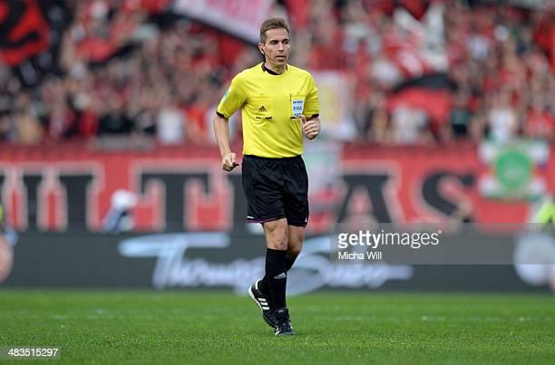 Referee Tobias Stieler looks on during the Bundesliga match between 1 FC Nuernberg and Borussia Moenchengladbach at Grundig Stadium on April 5 2014...