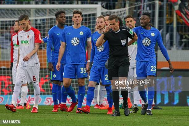 Referee Tobias Stieler looks on during the Bundesliga match between FC Augsburg and VfL Wolfsburg at WWKArena on November 25 2017 in Augsburg Germany