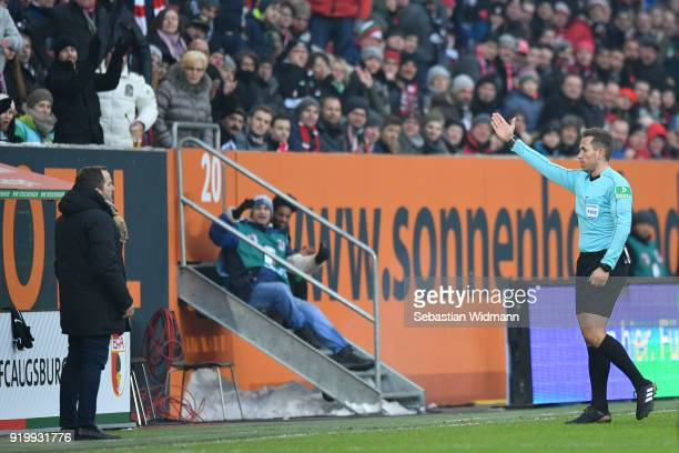 Referee Tobias Stieler sends head coach Manuel Baum of Augsburg off the pitch during the Bundesliga match between FC Augsburg and VfB Stuttgart at...