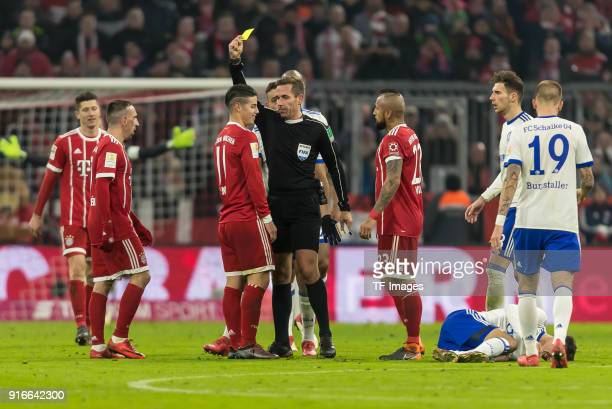Referee Tobias Stieler shows a yellow card to James Rodriguez of Muenchen during the Bundesliga match between FC Bayern Muenchen and FC Schalke 04 at...