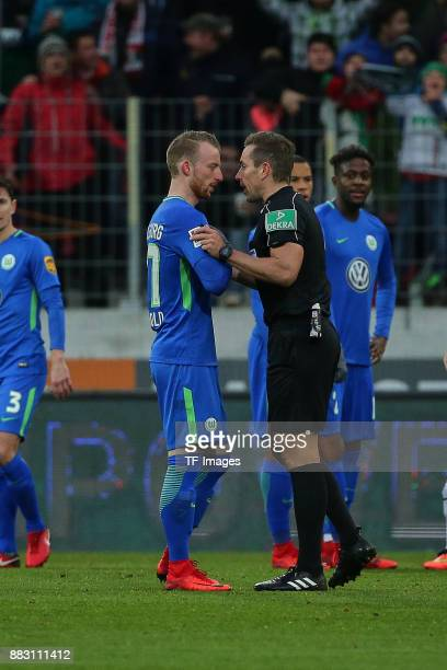 Referee Tobias Stieler speaks with Maximilian Arnold of Wolfsburg during the Bundesliga match between FC Augsburg and VfL Wolfsburg at WWKArena on...