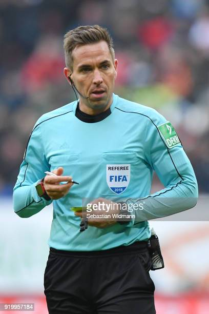 Referee Tobias Stieler takes notes during the Bundesliga match between FC Augsburg and VfB Stuttgart at WWKArena on February 18 2018 in Augsburg...