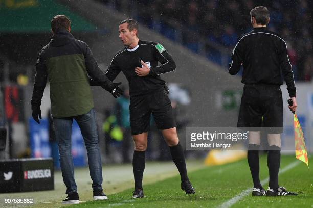 Referee Tobias Stieler talks to Coach Julian Nagelsmann of Hoffenheim during the Bundesliga match between TSG 1899 Hoffenheim and Bayer 04 Leverkusen...