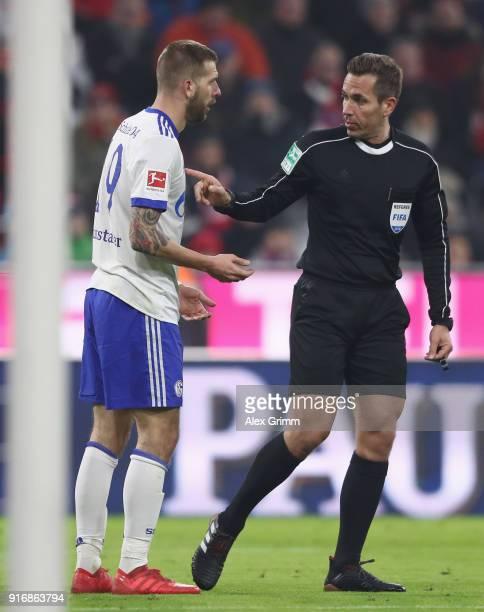 Referee Tobias Stieler talks to Guido Burgstaller of Schalke during the Bundesliga match between FC Bayern Muenchen and FC Schalke 04 at Allianz...