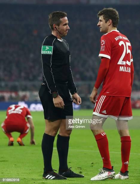 Referee Tobias Stieler talks to Thomas Mueller of Muenchen during the Bundesliga match between FC Bayern Muenchen and FC Schalke 04 at Allianz Arena...
