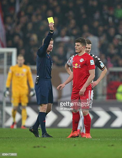 Referee Tobias Welz shows the yellow card to Marcel Sabitzer of RB Leipzig and Christopher Buchtmann of St Pauli 'n during the Second Bundesliga...