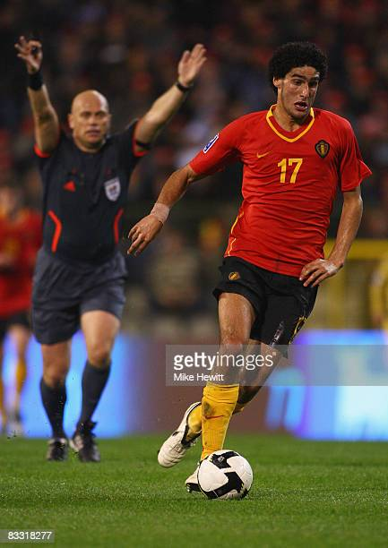 Referee Tom Henning Ovrebo from Norway plays advantage with Marouane Fellaini of Belgium in possession during the FIFA 2010 World Cup Group 5...