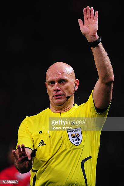 Referee Tom Henning Ovrebo gestures during the UEFA Champions League Quarter Final 2nd leg match between Manchester United and AS Roma at Old...