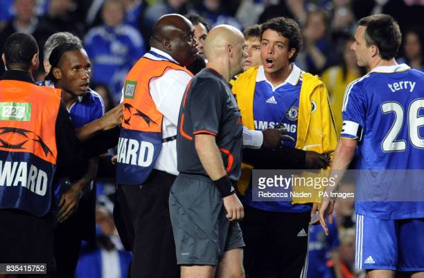Referee Tom Henning Ovrebo is surrounded by Chelsea players after the final whistle of the final whistle during the UEFA Champions League Semi Final...
