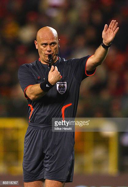Referee Tom Henning Ovrebo of Norway gestures and blows his whistle during the FIFA 2010 World Cup Group 5 Qualifier between Belgium and Spain at the...