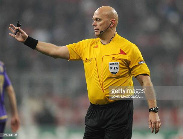 Referee Tom Henning Ovrebo of Norway gestures towards players during the Bayern Munich vs ACF Fiorentina Champions League round of 16 football match...