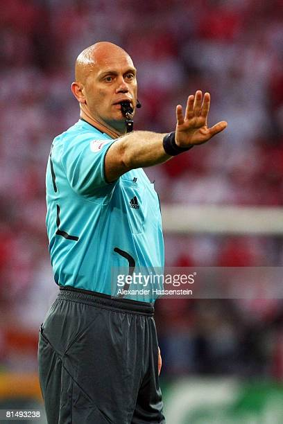 Referee Tom Henning Ovrebo of Norway signals during the UEFA EURO 2008 Group B match between Germany and Poland at Worthersee Stadion on June 8, 2008...