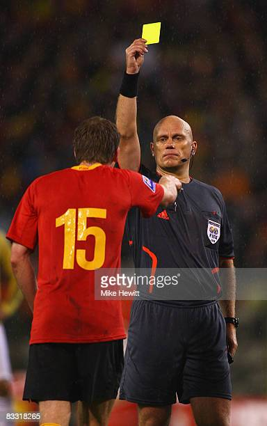 Referee Tom Henning Ovrebo shows a yellow card to Jan Vertonghen of Belgium during the FIFA 2010 World Cup Group 5 Qualifier between Belgium and...