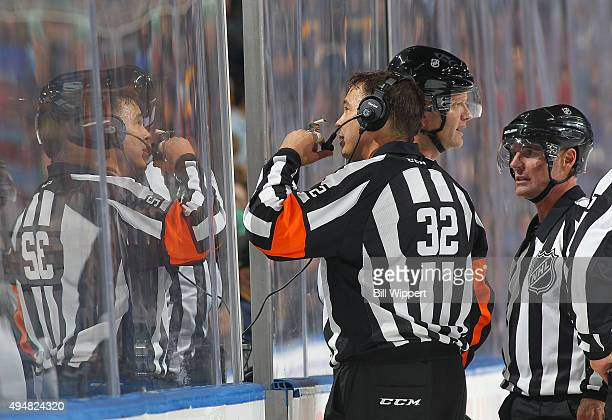 Referee Tom Kowal checks on a video review during a NHL game between the Buffalo Sabres and the New Jersey Devils on October 24 2015 at the First...