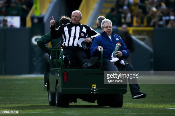 Referee Tom Stephan is carted off the field after being injured in the first quarter during the game between the Green Bay Packers and the Tampa Bay...