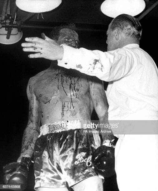 Referee Tommy Little stops the fight in the fifth round to save Henry Cooper from 'annihilation' in Little's words after Cassius Clay systematically...