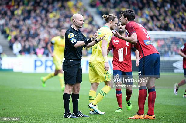 Referee Tony Chapron and Renato Civelli of Lille during the French League 1 match between Fc Nantes and Lille OSC at Stade de la Beaujoire on April 3...
