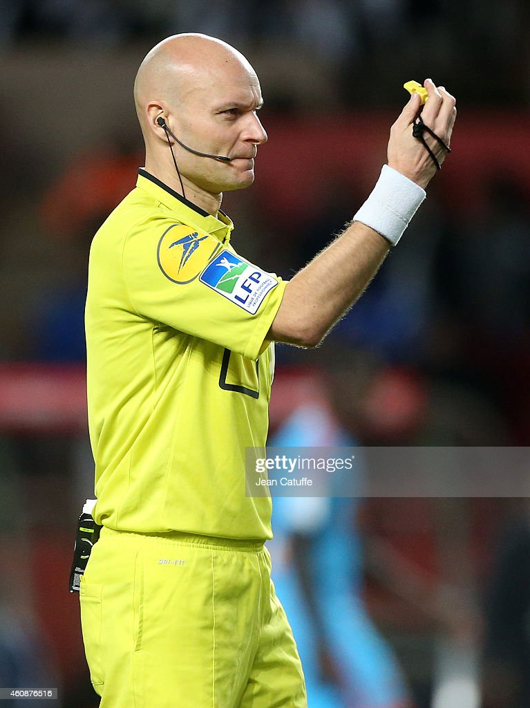 Referee Tony Chapron in action during the French Ligue 1 match between AS Monaco FC v Olympique de Marseille OM at Stade Louis II on December 14, 2014 in Monaco.
