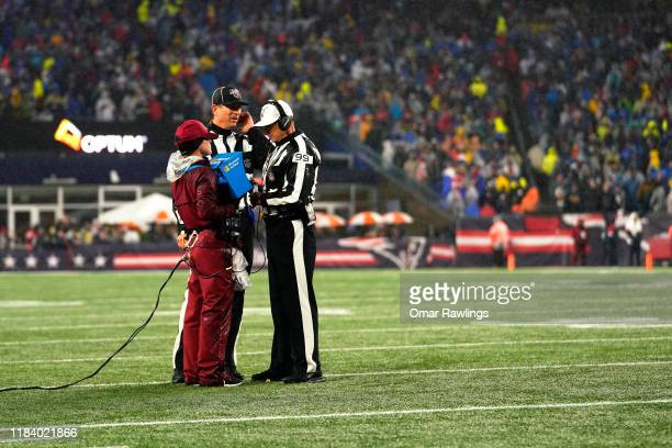 Referee Tony Corrente and Umpire Bill Schuster review a play during the second quarter of the game between the New England Patriots and the Cleveland...