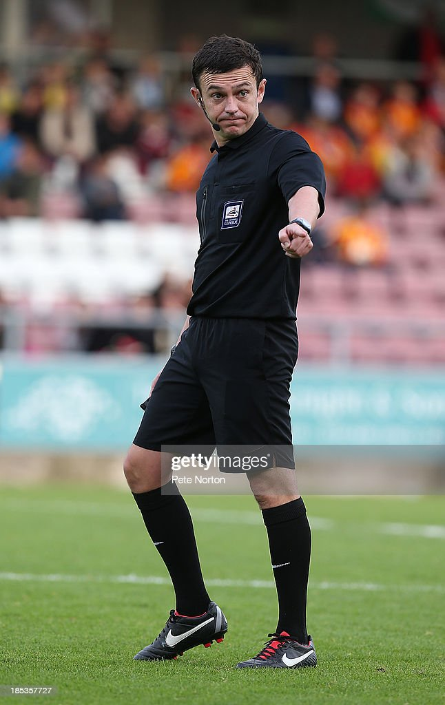 Referee Tony Harrington in action during the Sky Bet League Two match between Northampton Town and Dagenham & Redbridge at Sixfields Stadium on October 19, 2013 in Northampton, England.