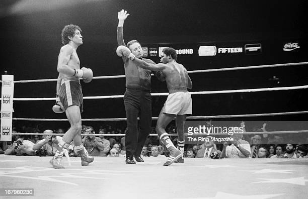Referee Tony Perez grabs Azumah Nelson as he stops the fight against Salvador Sanchez at Madison Square Garden on July 21 1982 in New York New York...