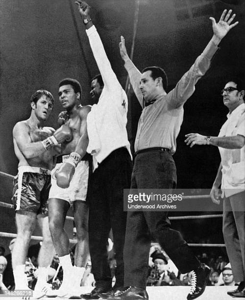 Referee Tony Perez signals the end of the fight between Muhammad Ali and Jerry Quarry Atlanta Georgia October 26 1970 Angelo Dundee Ali's manager is...