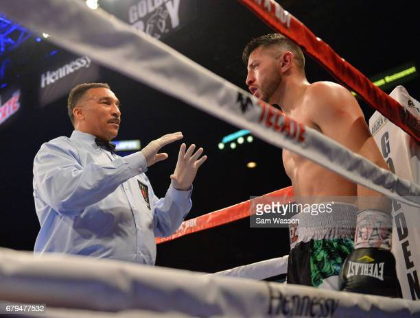 Referee Tony Weeks delivers a count to Abraham Lopez during his featherweight fight against Jesus Rojas at MGM Grand Garden Arena on May 5 2017 in...