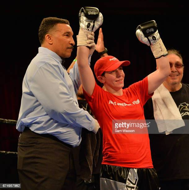 Referee Tony Weeks holds up Layla McCarter's arm after she won her welterweight fight against Szilvia Szabados at Sam's Town Hotel Gambling Hall on...