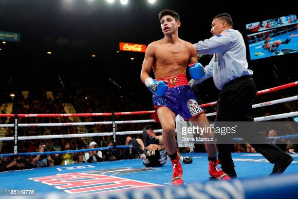 Referee Tony Weeks sends Ryan Garcia to a neutral corner after he knocked down Romero Duno in the first round of a lightweight fight at MGM Grand...