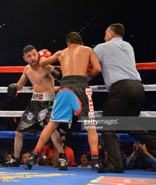 Referee Tony Weeks stops the featherweight fight between Abraham Lopez and Jesus Rojas at MGM Grand Garden Arena on May 5 2017 in Las Vegas Nevada...