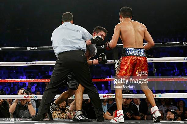 Referee Tony Weeks stops the fight in the ninth round as Francisco Vargas defeats Takashi Miura by TKO during their WBC super featherweight title...
